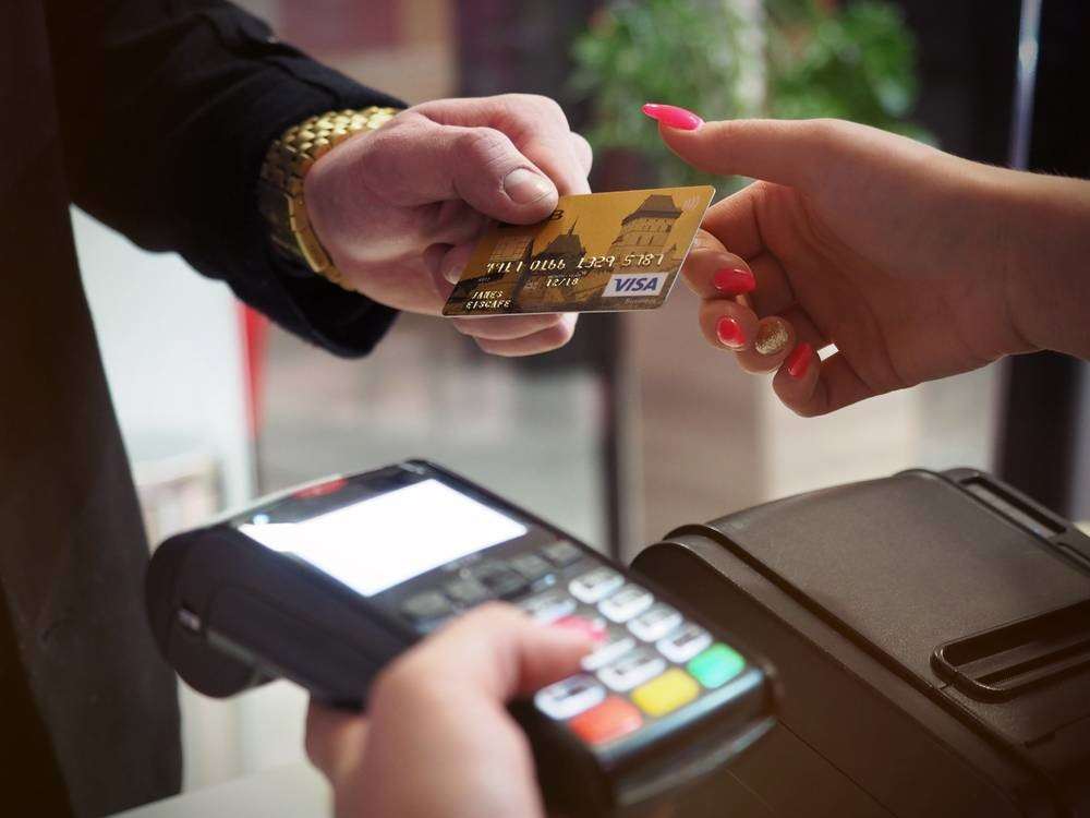 Unrecognizable person taking check from cash register